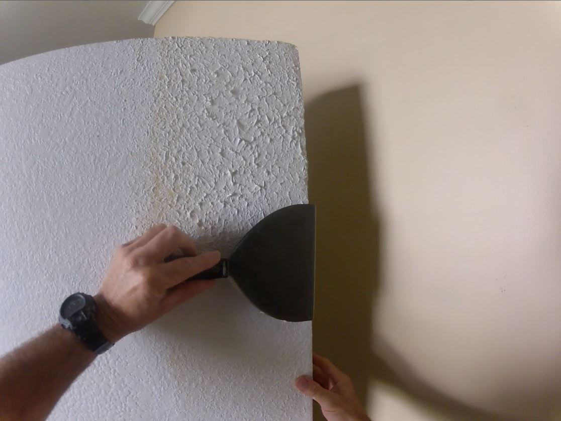 Knocking down the knockdown sponge texture after letting it set up for about 10 minutes